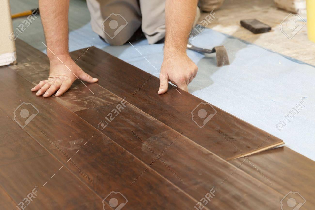 Man Installing New Laminate Wood Flooring Abstract Stock Photo - New Laminate Flooring