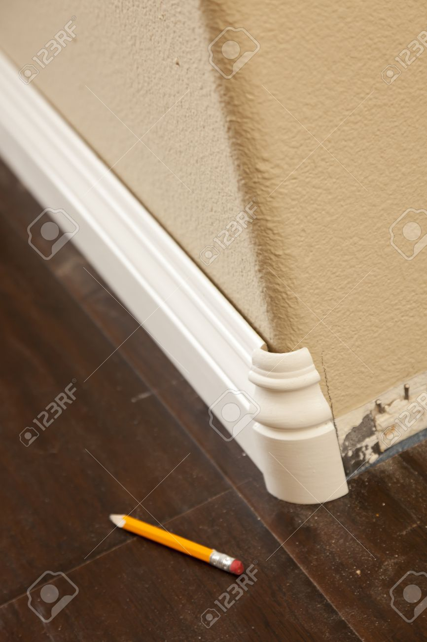 New Baseboard And Bull Nose Corners With Laminate Flooring Abstract Stock Photo 14202865