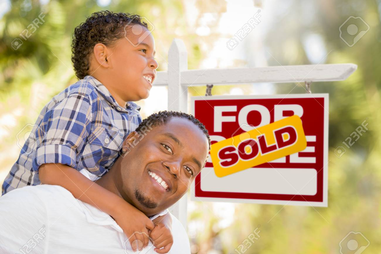 Happy African American Father and Mixed Race Son in Front of Sold Real Estate Sign. Stock Photo - 14990553