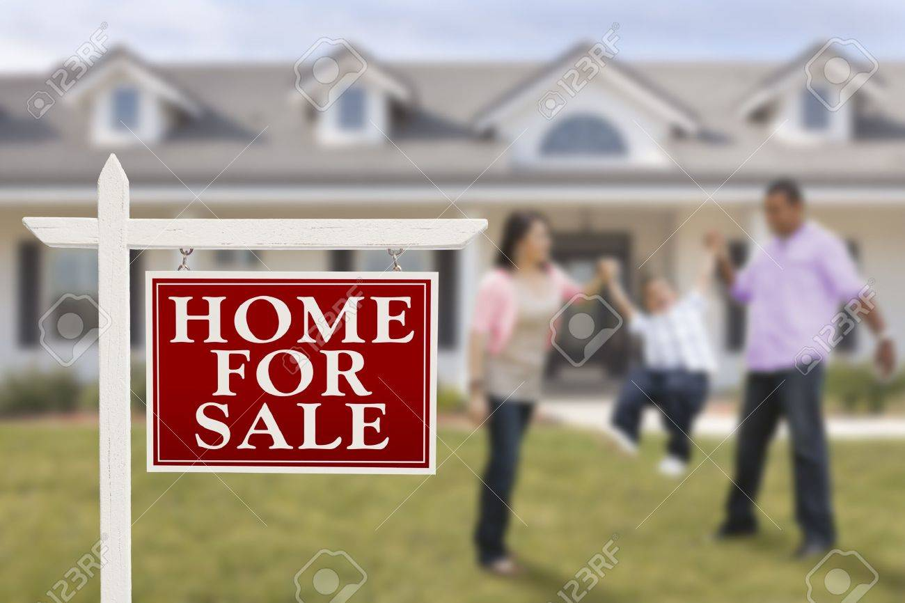 Home For Sale Real Estate Sign and Playful Hispanic Family in Front of House. Stock Photo - 15467455