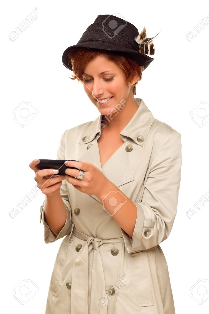 Smiling Young Woman Holding Smart Cell Phone Isolated on a White Background. Stock Photo - 17001954