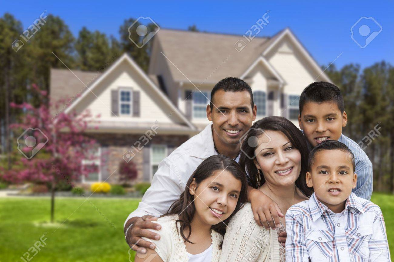 Happy Hispanic Family Portrait in Front of Beautiful House Stock Photo - 19223738