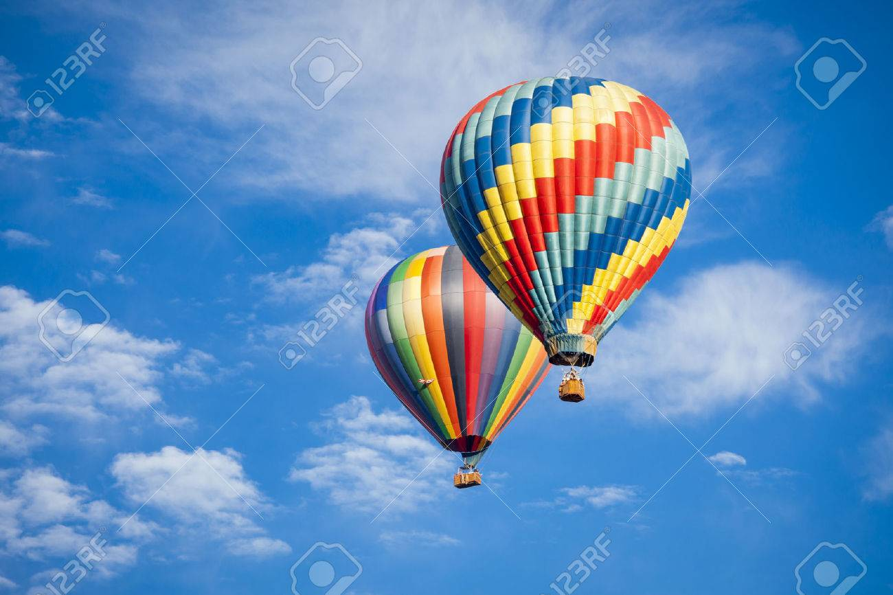 Beautiful Hot Air Balloons Against a Deep Blue Sky and Clouds. - 27145002