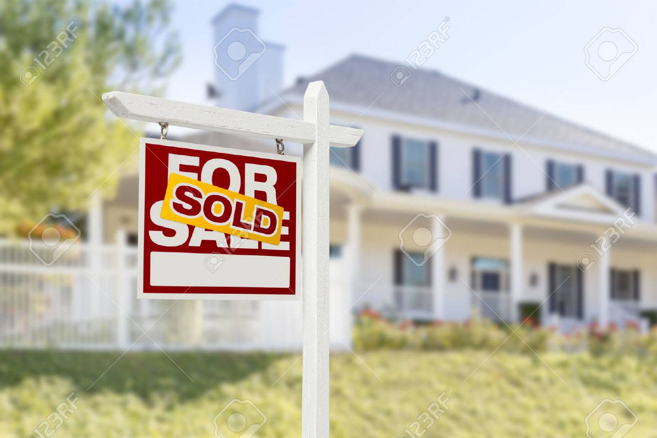 sold home for sale real estate sign in front of beautiful new house stock photo