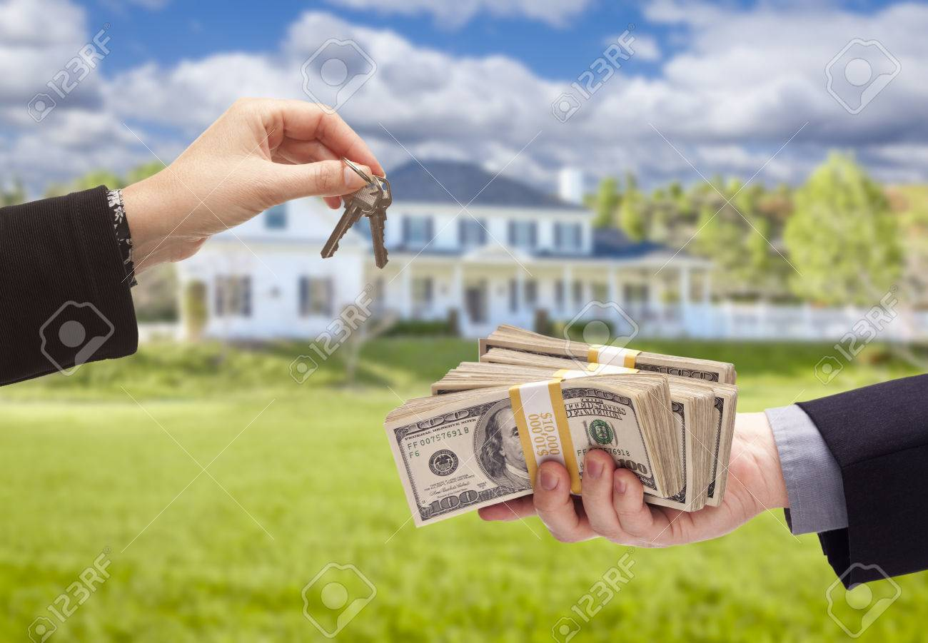 Handing Over Cash For House Keys In Front Of Beautiful New Home Stock Photo  Download Image How To Buy A House Houston Solution