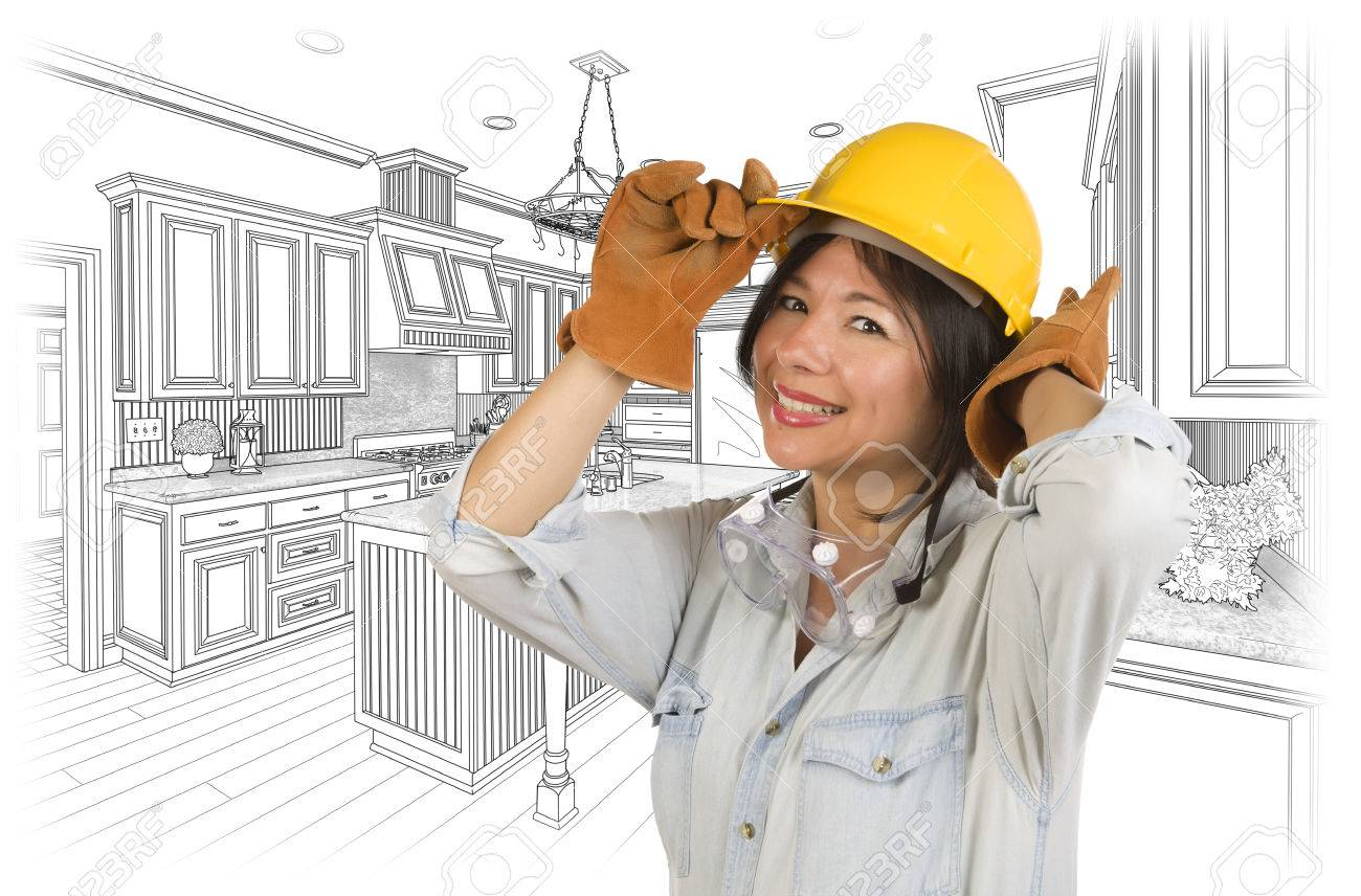 pretty hispanic woman in hard hat and gloves with kitchen drawing