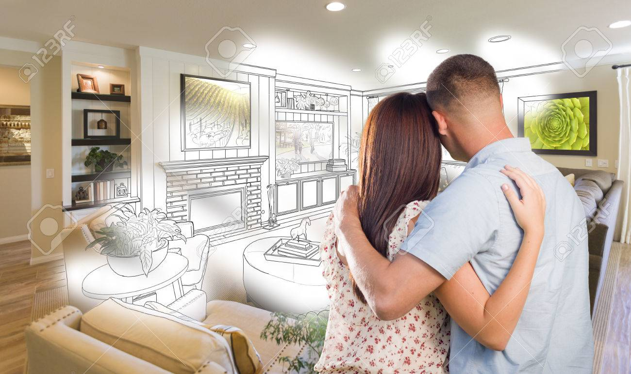 Curious Young Military Couple Looking Over Custom Living Room ...