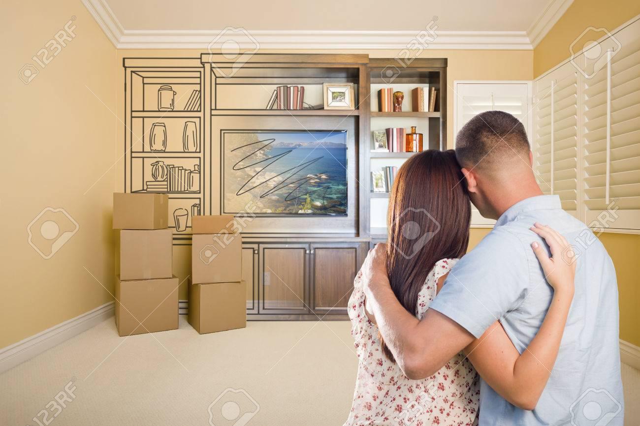 Junge Militär Paare An Zeichnung Der Entertainment Einheit Im Zimmer Der  Suche Mit Beweglichen Boxen