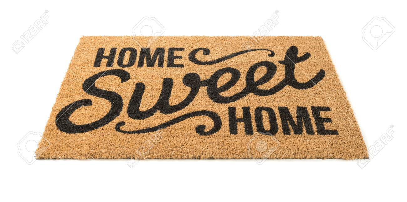 Home Sweet Home Welcome Mat Isolated On A White Background. Stock Photo    69329558