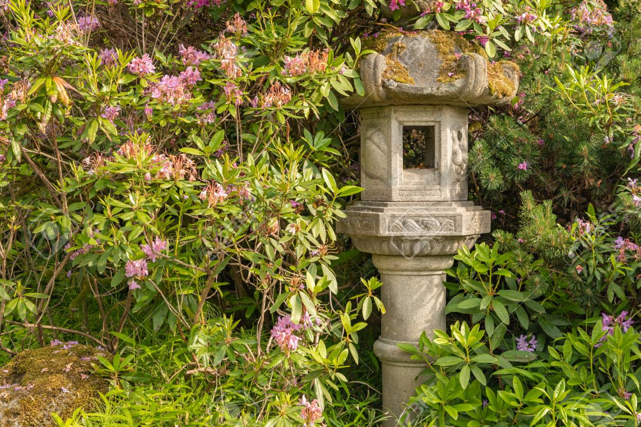 Japanese Pagoda Lantern Within Green Garden Setting