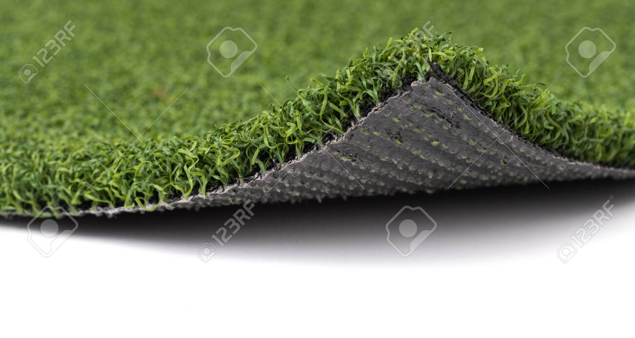 Flipped Up Section of Artificial Turf Grass On White Background. - 137640009