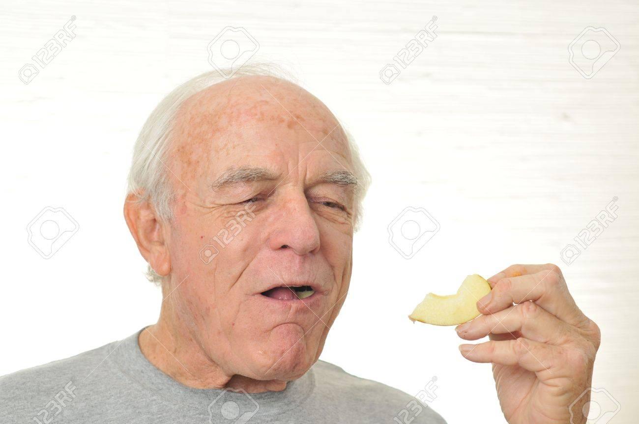6076060-A-happy-man-eats-a-slice-of-appl