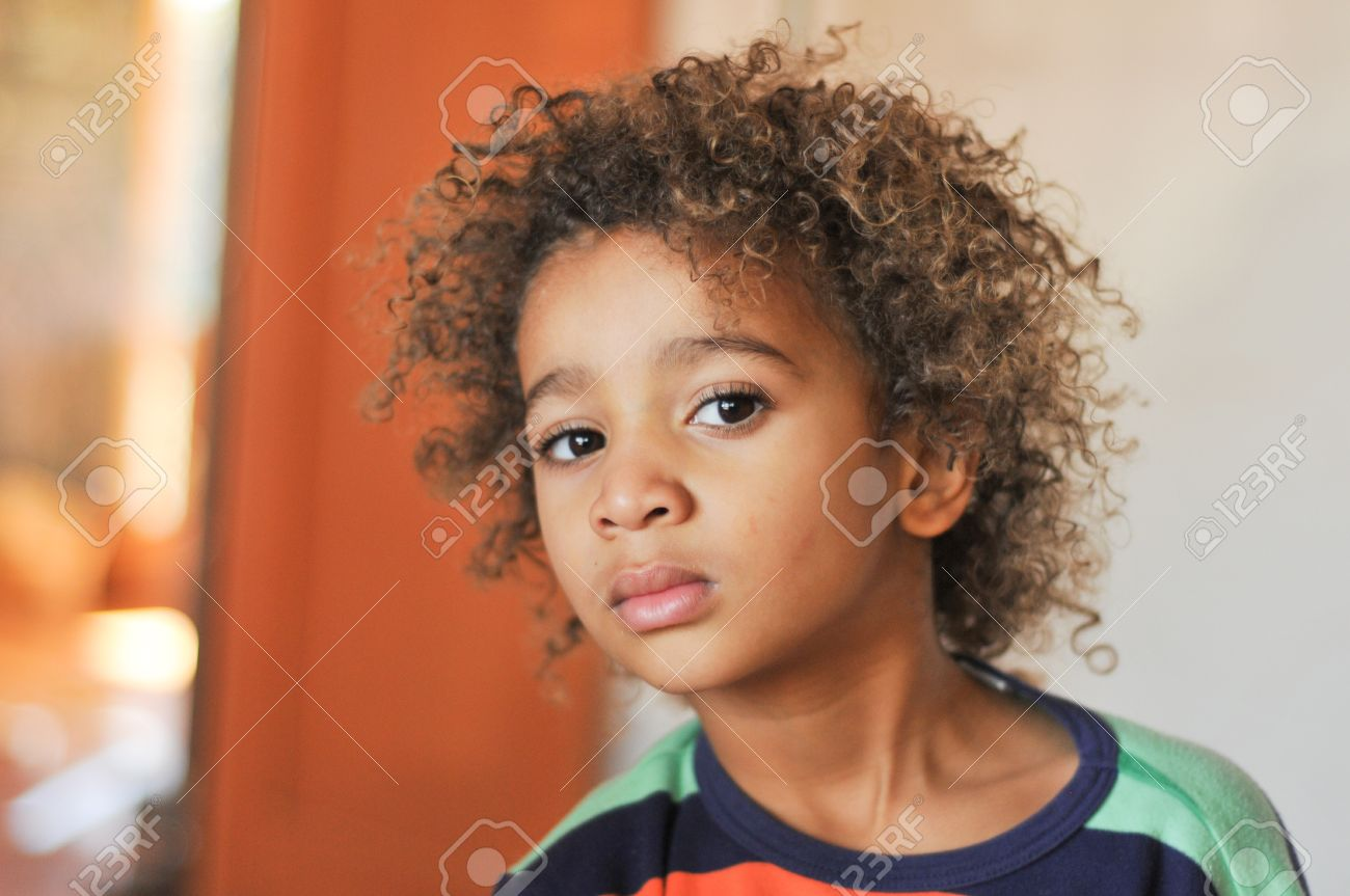 Curly Hair Mixed Race Boy Posing For Portrait Stock Photo Picture And Royalty Free Image Image 17382402