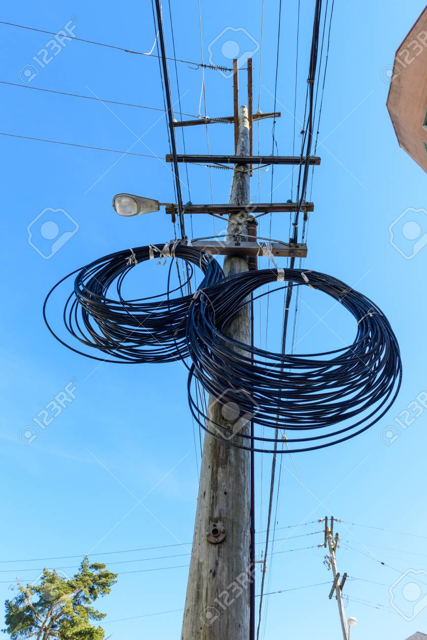 Additional Wire Hangs On A Telephone Pole In Two Circles Stock Photo ...