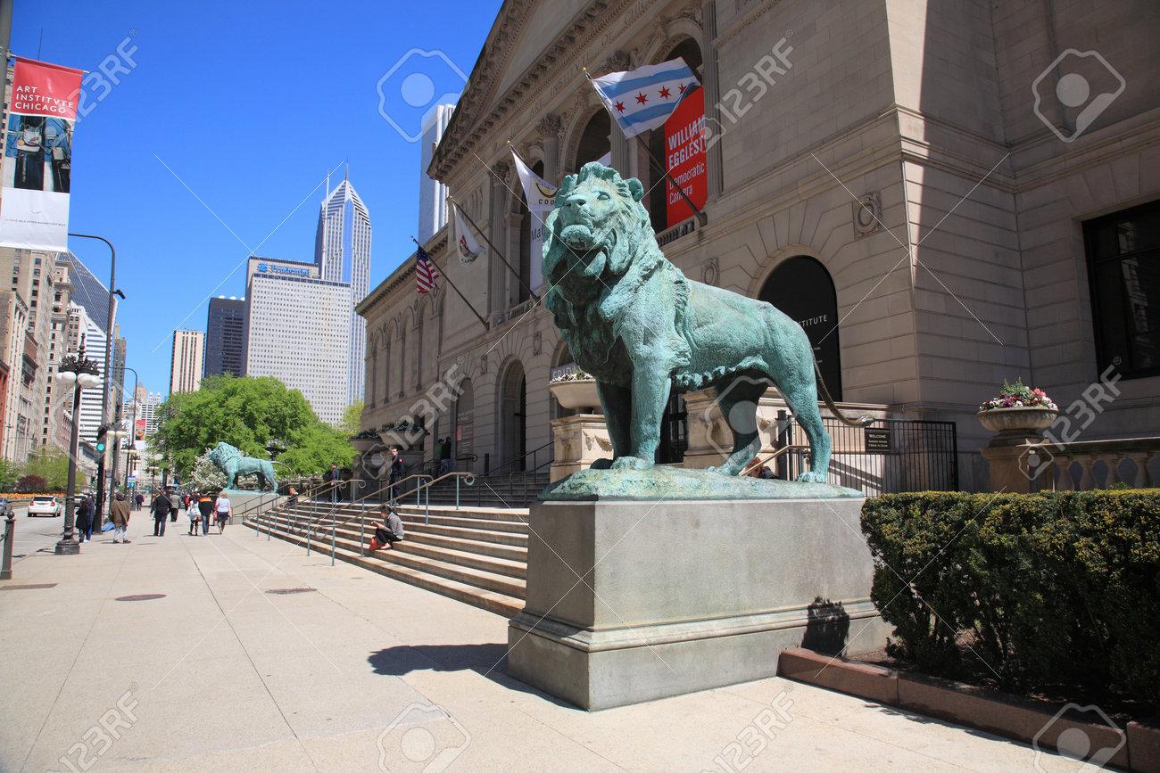 Chicago, Illinois - April 26, 2010: Chicago Art Institute near Grant Park in Chicago, Illionois. Famous lion statues are found outside on Michigan Avenue. Stock Photo - 9020134