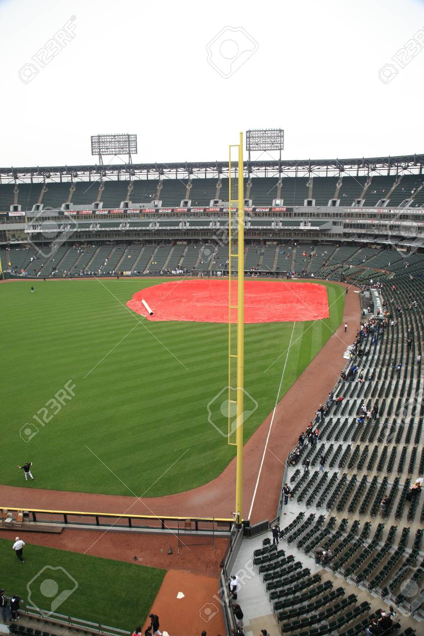 Chicago, Illinois - April 25, 2010: White Sox fans during a rain delay at U.S. Cellullar Field.   Stock Photo - 9021045