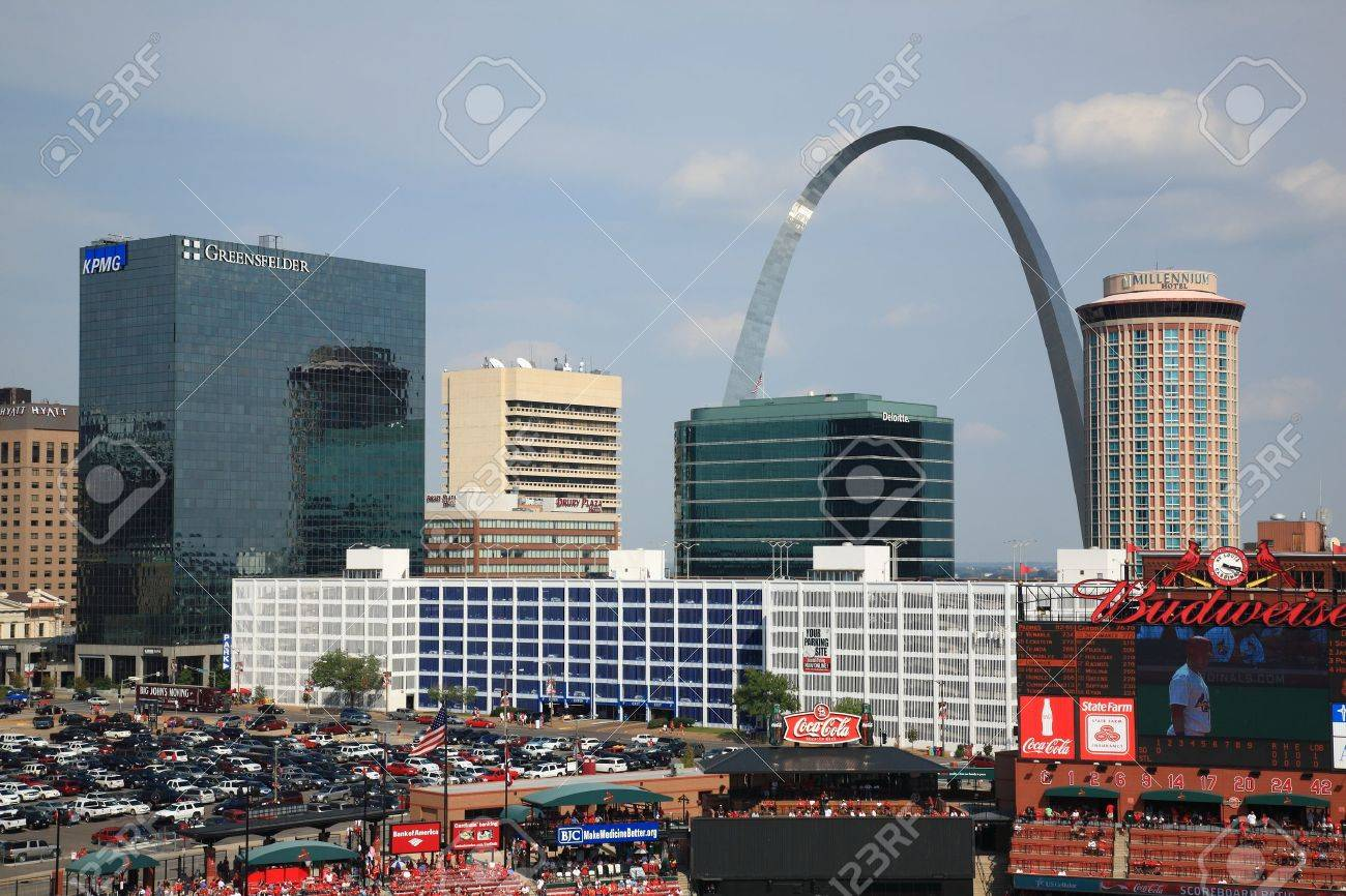 St. Louis, September 18, 2010: Fans gather for a late season Cardinals game at Busch Stadium, under the Gateway Arch. Stock Photo - 9036395