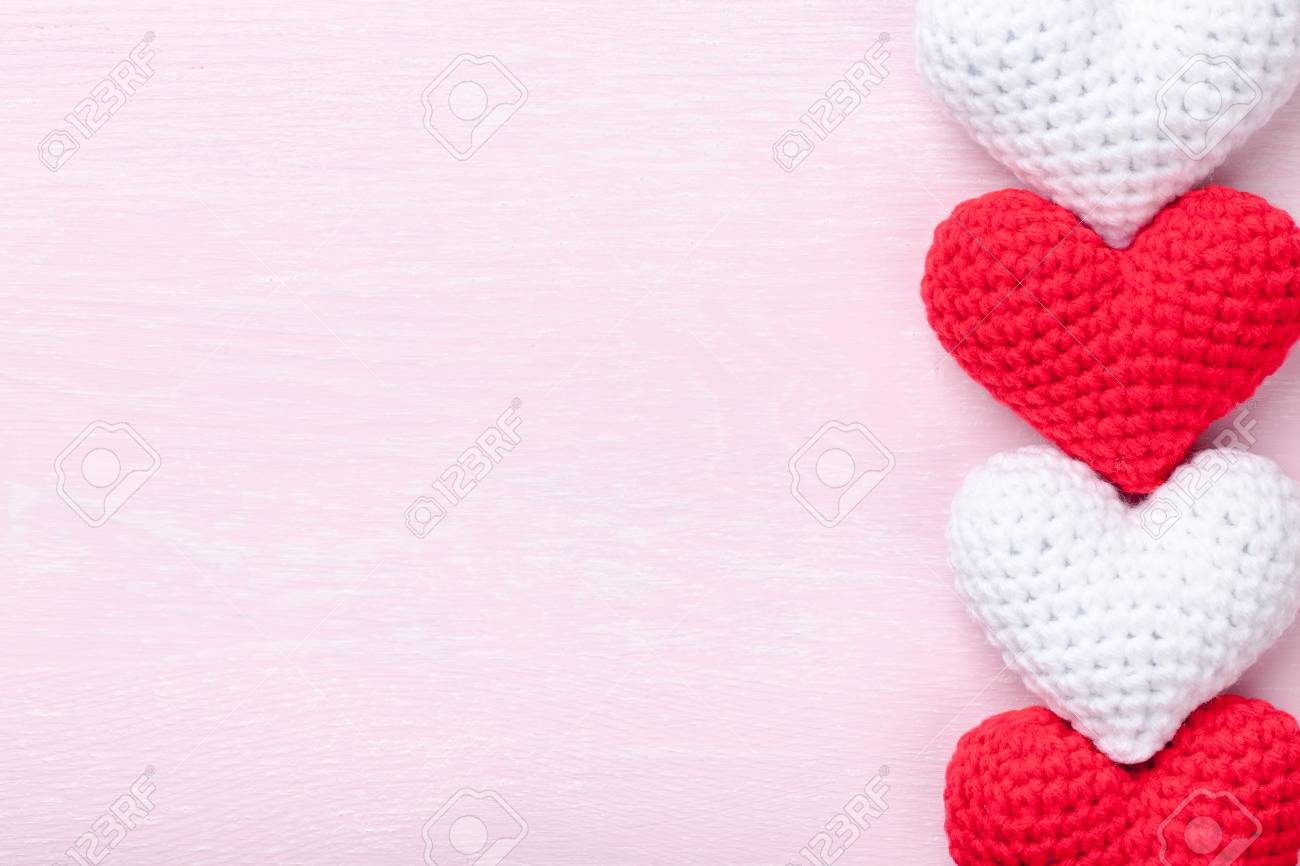 Crochet Hearts On Pink Wooden Background Stock Photo Picture And Royalty Free Image Image 77295344