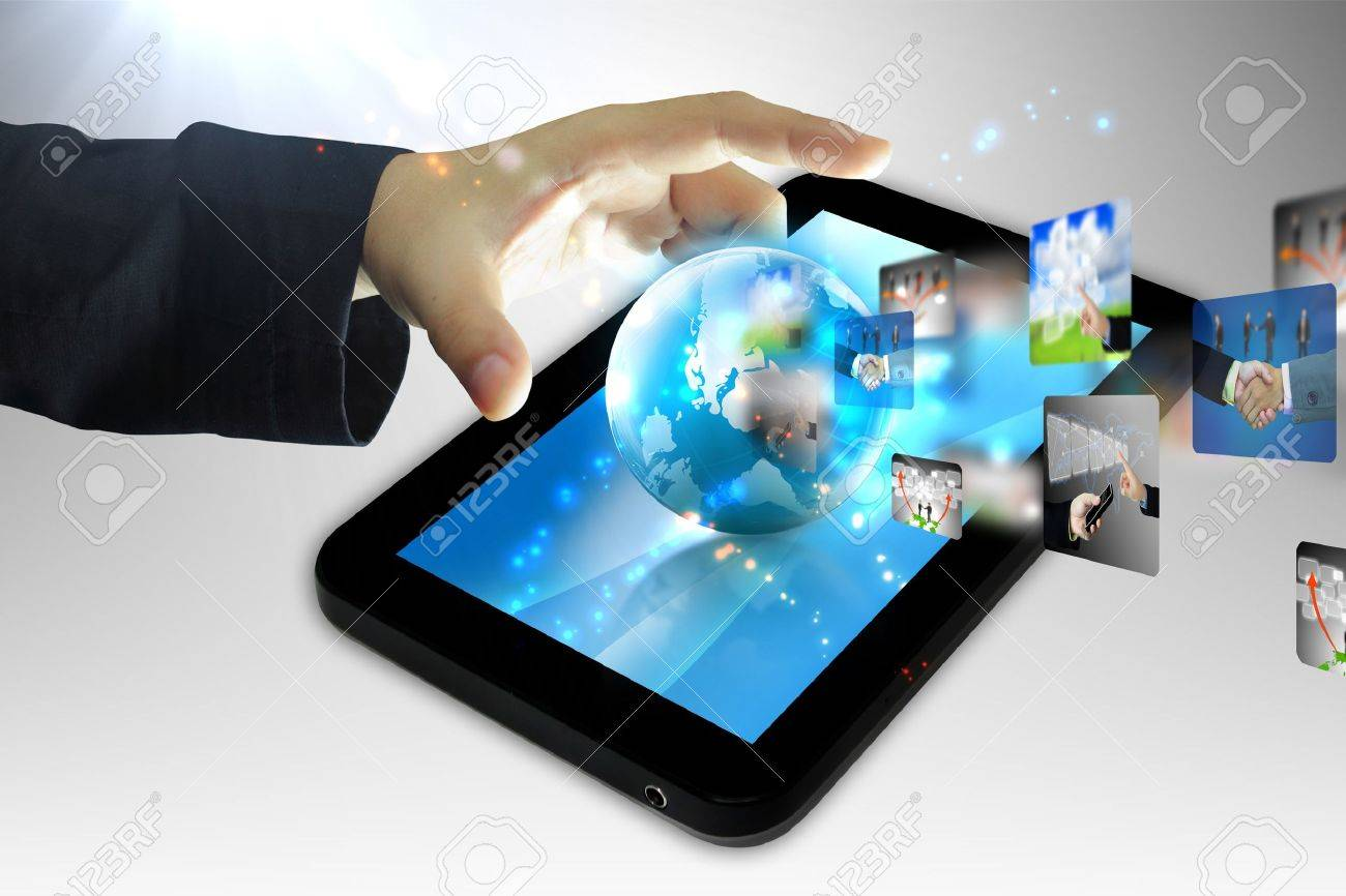 hand holding business world on tablet pc Stock Photo - 13935599