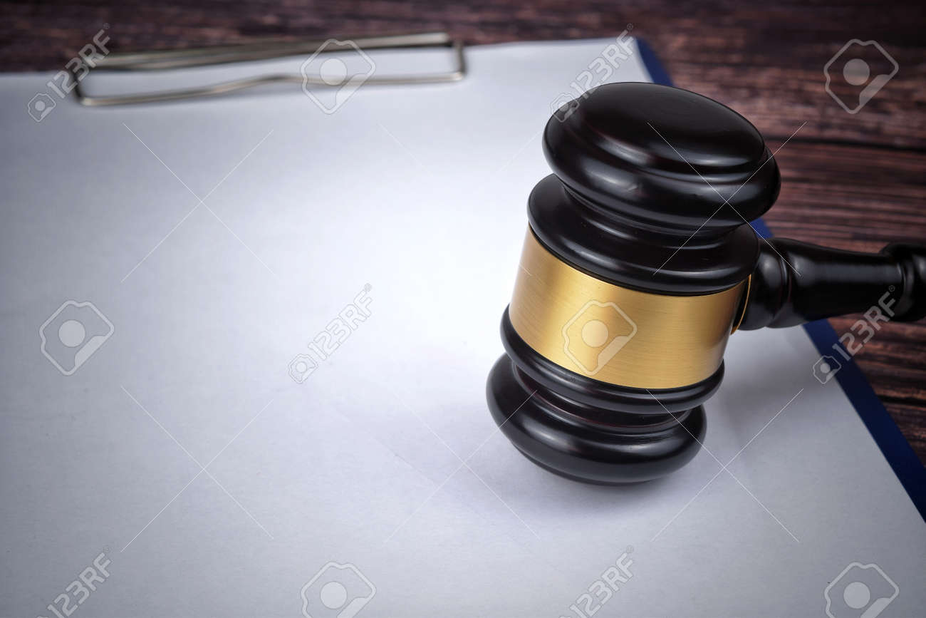 Selective focus image of gavel isolated over a wooden background. Law concept - 166829895