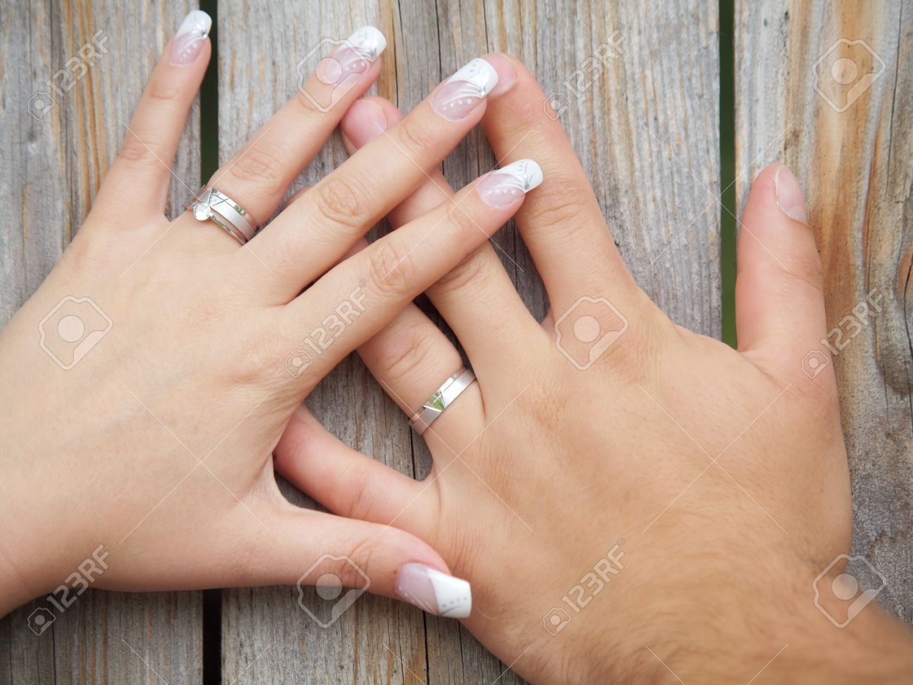 Charmant Still Life Two Hands With Wedding Rings Stock Photo   17526369
