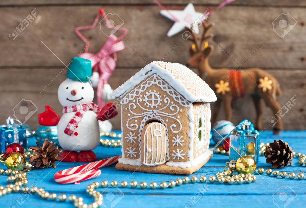 Homemade Gingerbread House With Candy Windows On A Blue Wooden