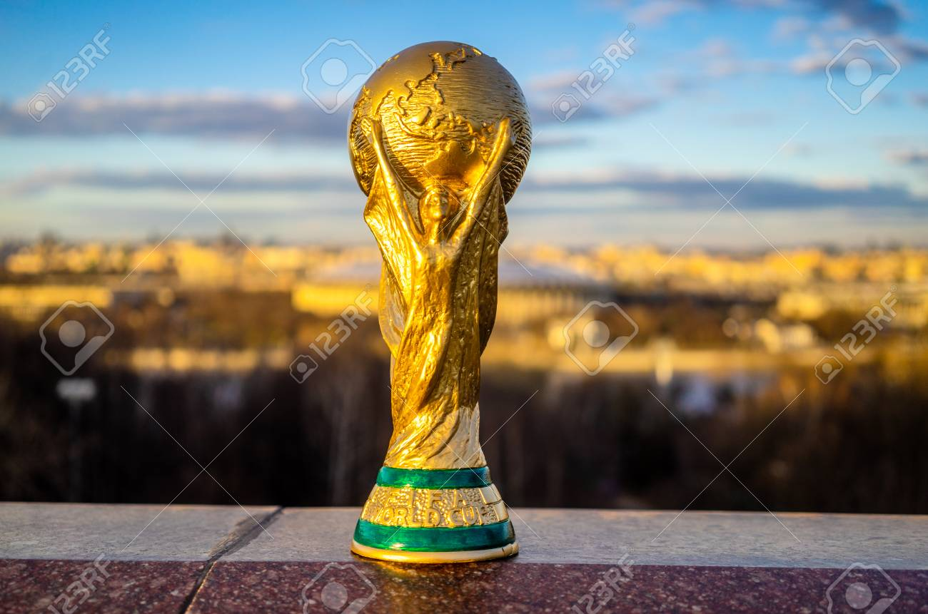 April 13, 2018 Moscow, Russia Trophy of the FIFA World Cup against the backdrop of the Luzhniki stadium in Moscow. - 101711518