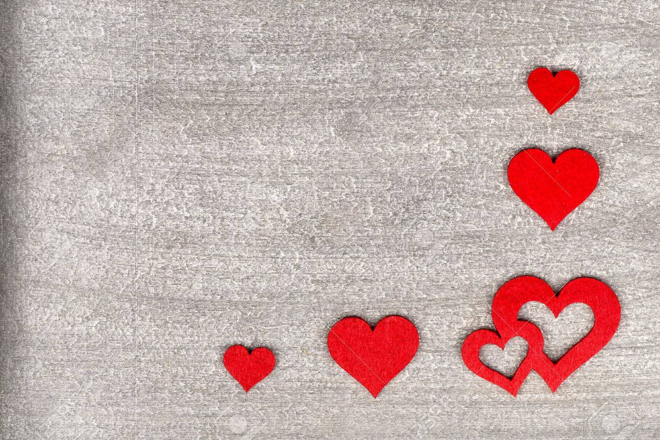 Rustic Wooden Background With Bright Red Hearts And Free Text Space As A Greeting For Valentine