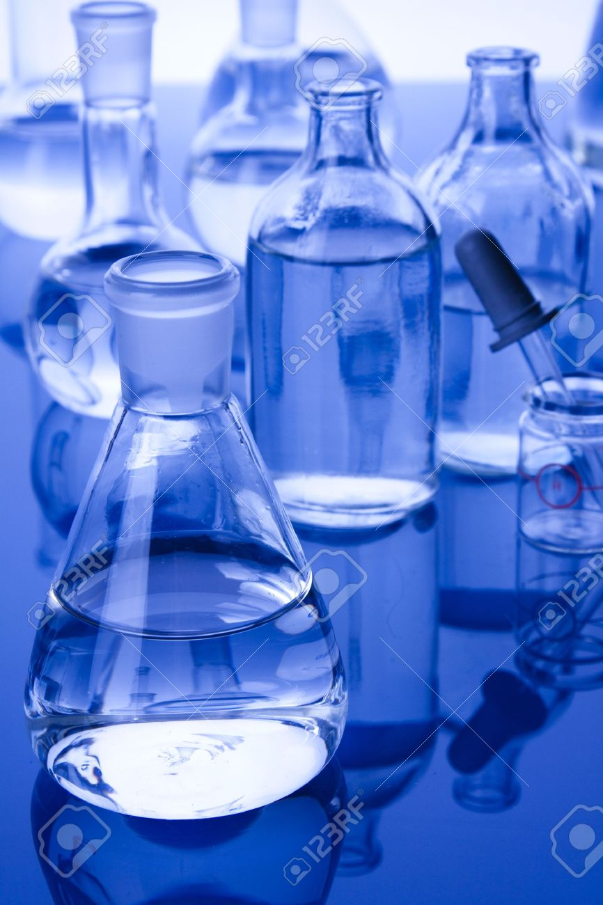 Laboratory glassware in blue background Stock Photo - 8549778