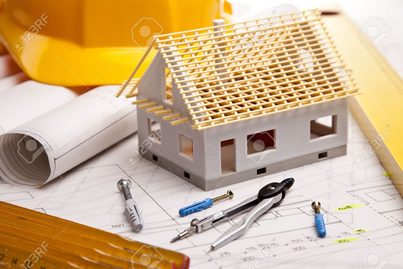 Construction plans with helmet and drawing tools on blueprints Stock Photo - 11637780