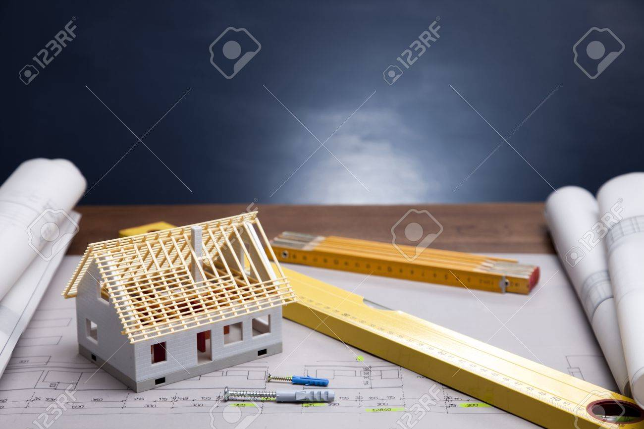 Construction plans and blueprints on wooden table Stock Photo - 11637759