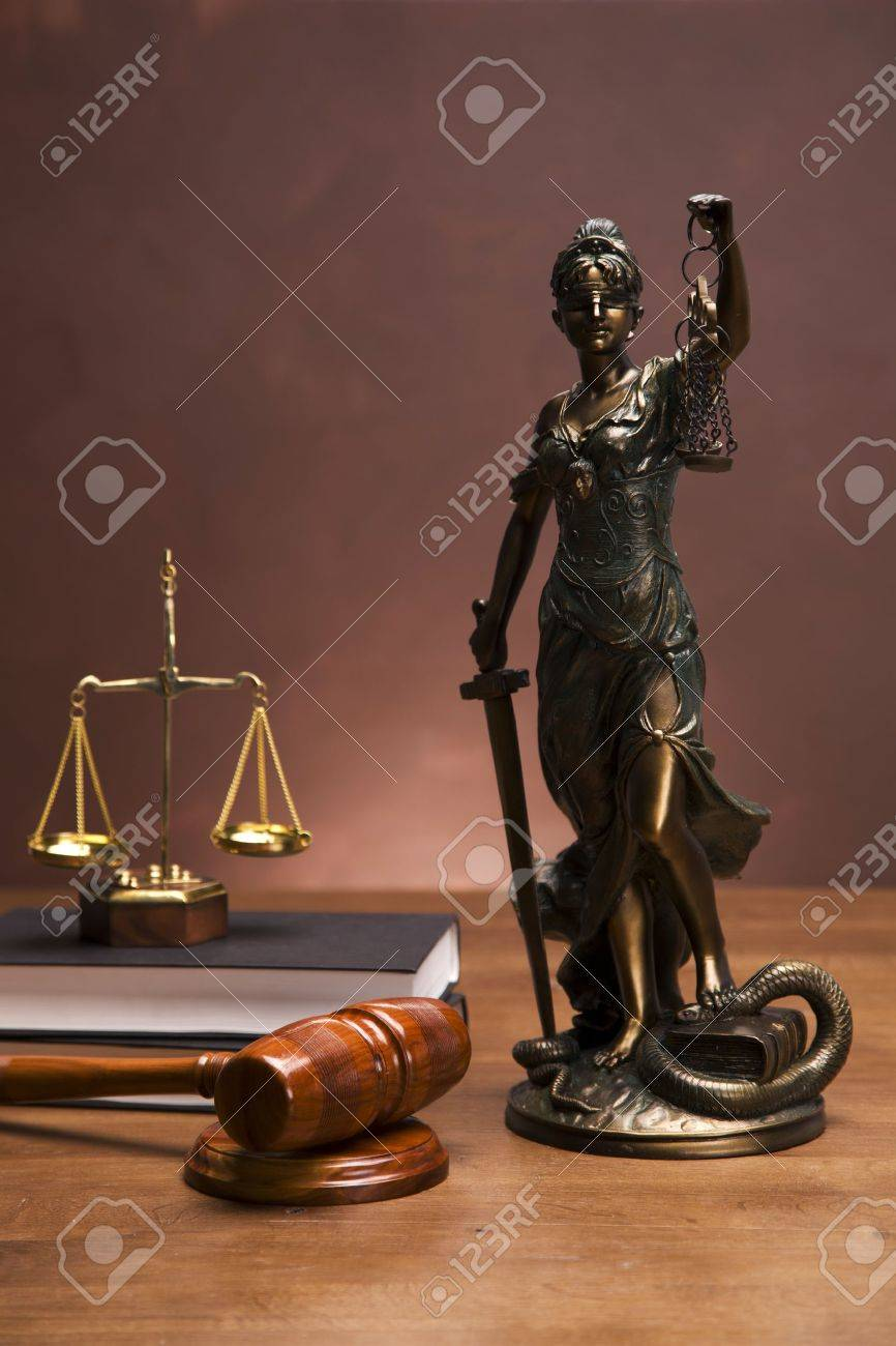 Scales of justice and gavel on desk with dark background Stock Photo - 11621110