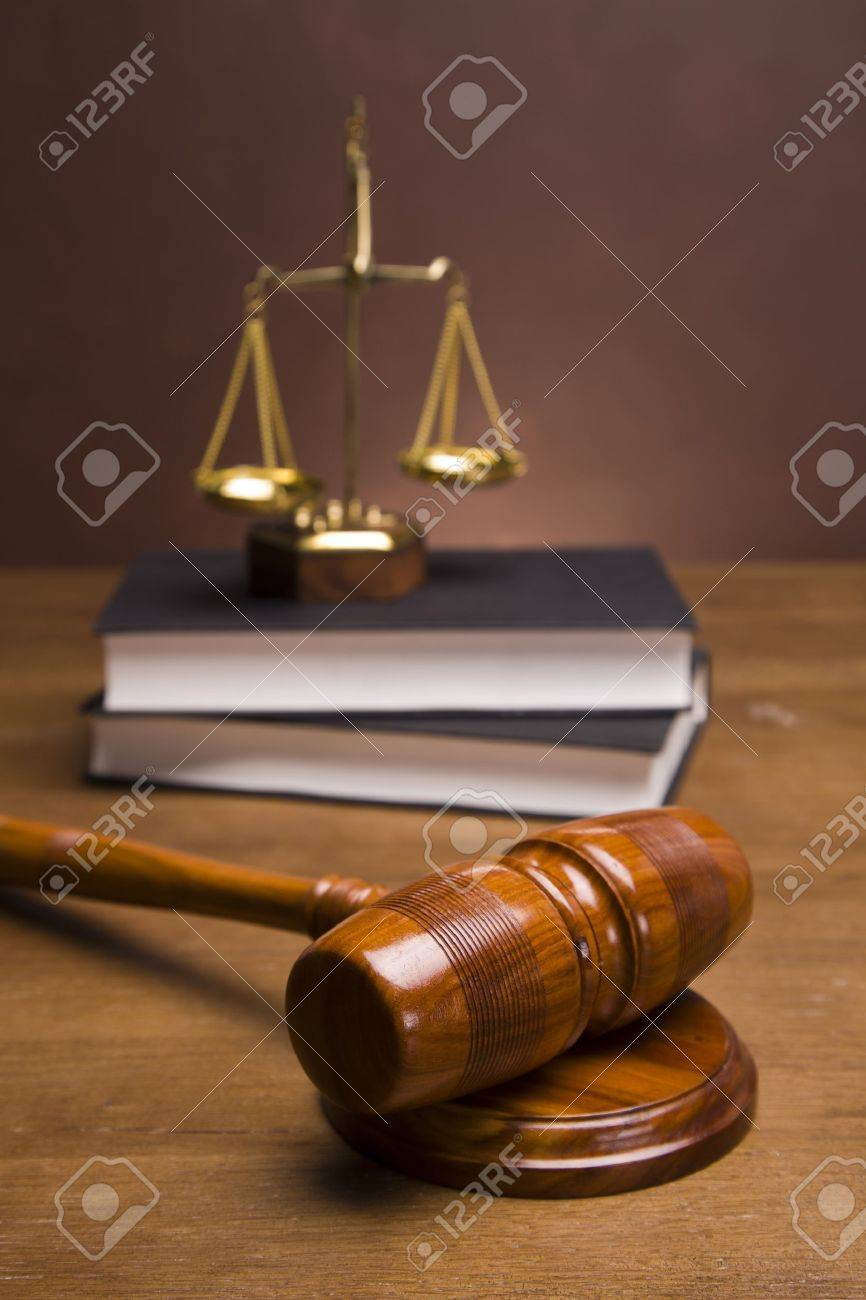 Scales of justice and gavel on desk with dark background Stock Photo - 11621072