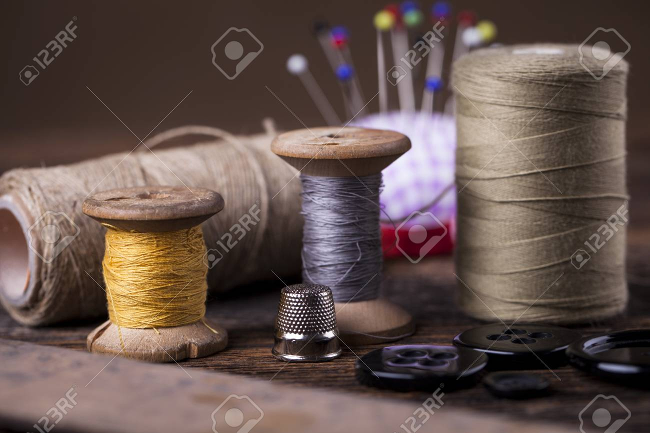 Sewing instruments, threads, needles, bobbins and materials. Studio photo - 85114442