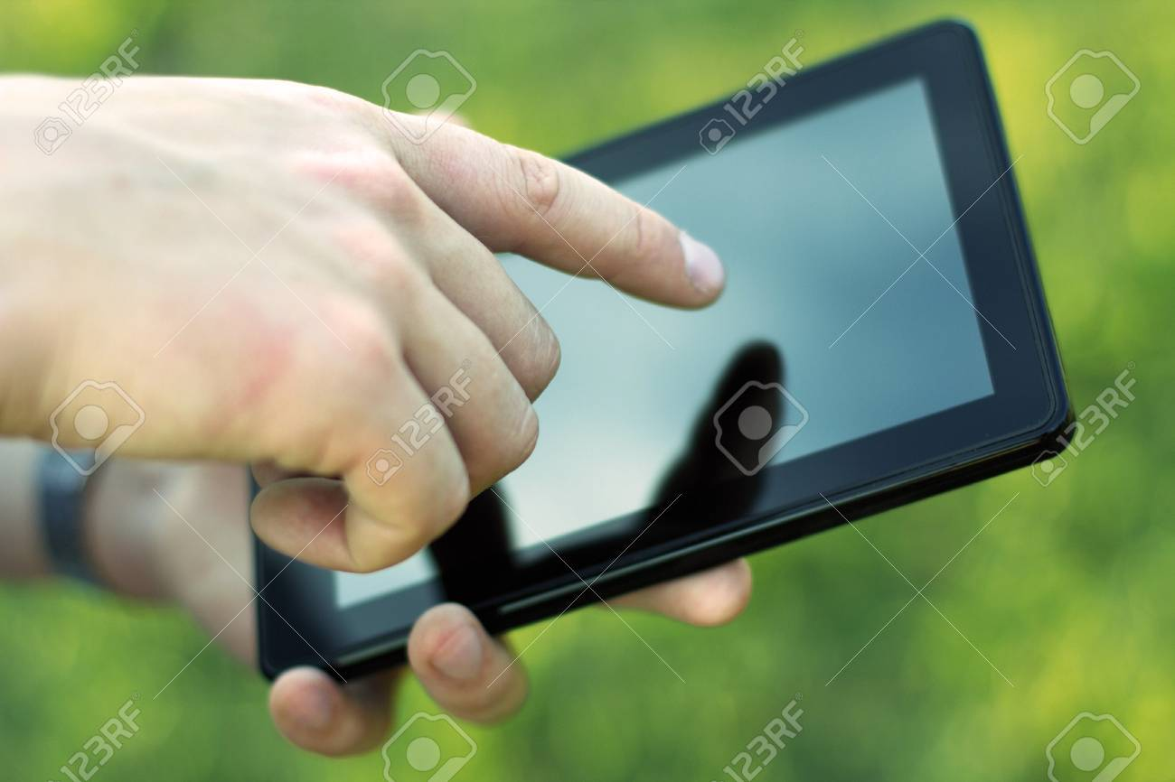 Hand touching screen on modern digital tablet pc  Close-up image Stock Photo - 14792195