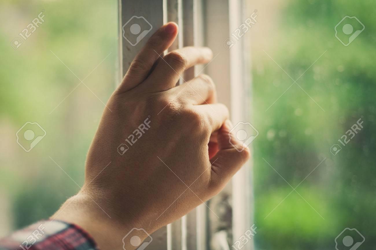 Hand opens a window Standard-Bild - 22866226