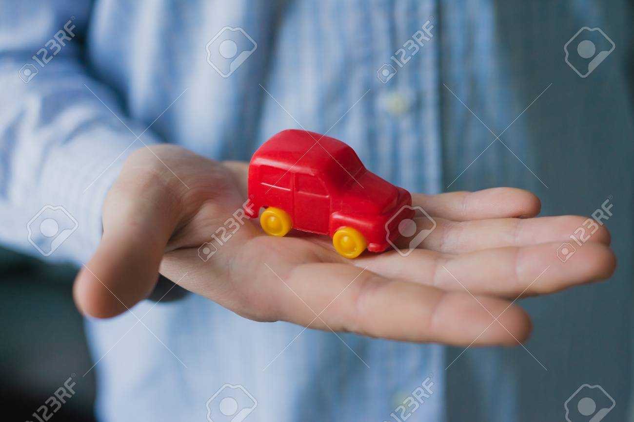 Man holds in his hand cars Stock Photo - 24585124