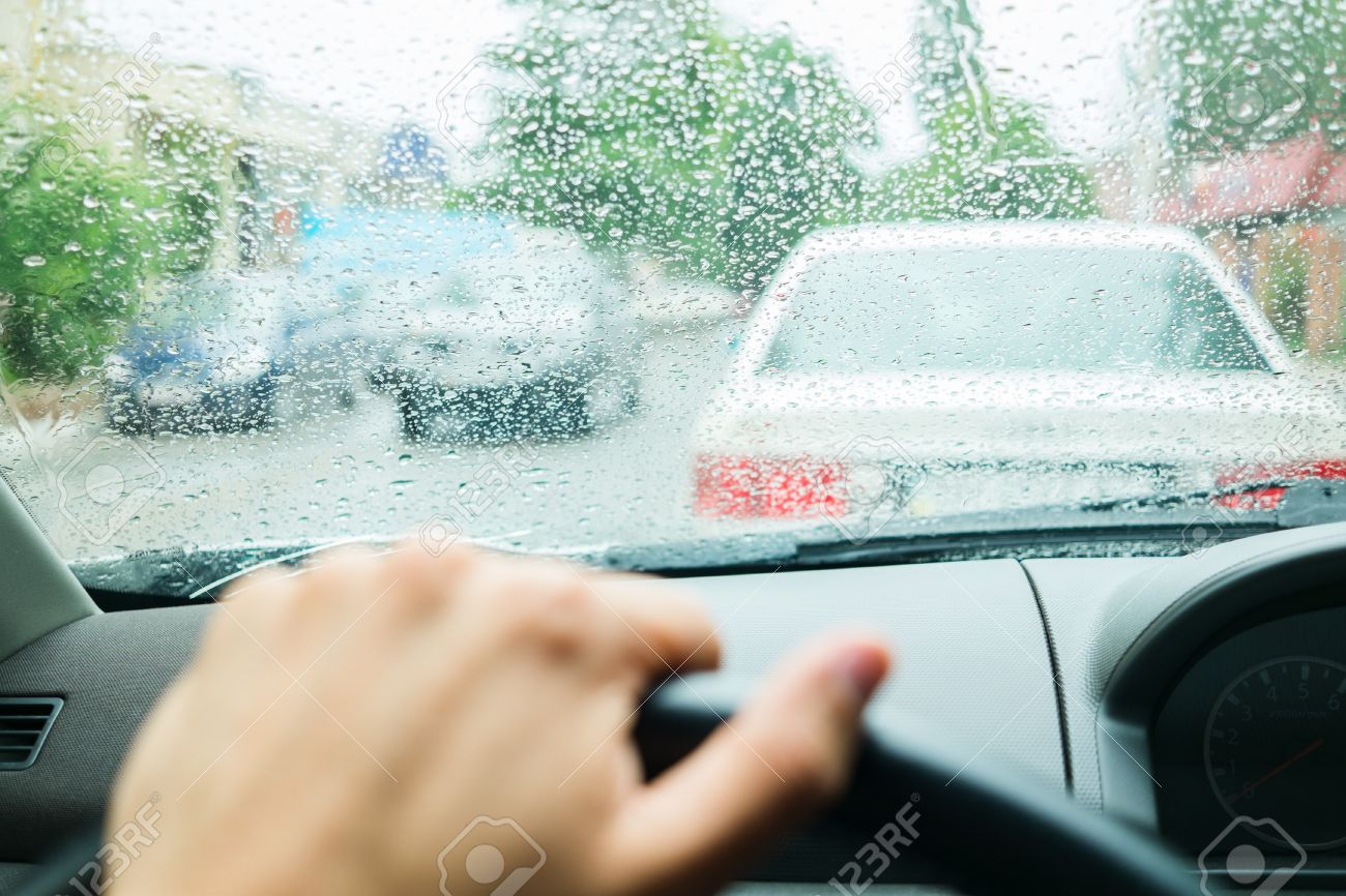 rain drops on car glass in rainy days - 33713372
