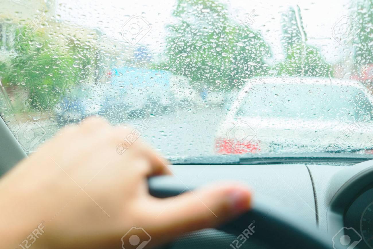 Driving in rain. Raindrops on the windshield Standard-Bild - 33709903