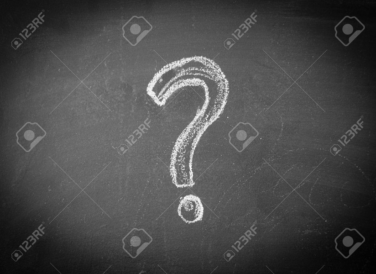Question mark drawn in chalk on a blackboard - 33713626