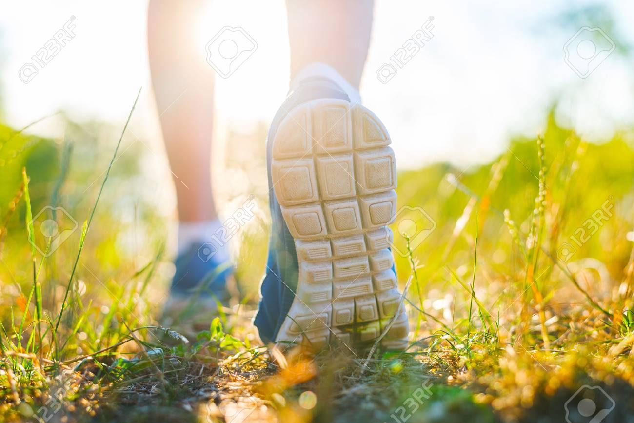 Runner feet running closeup on shoe - 33725513