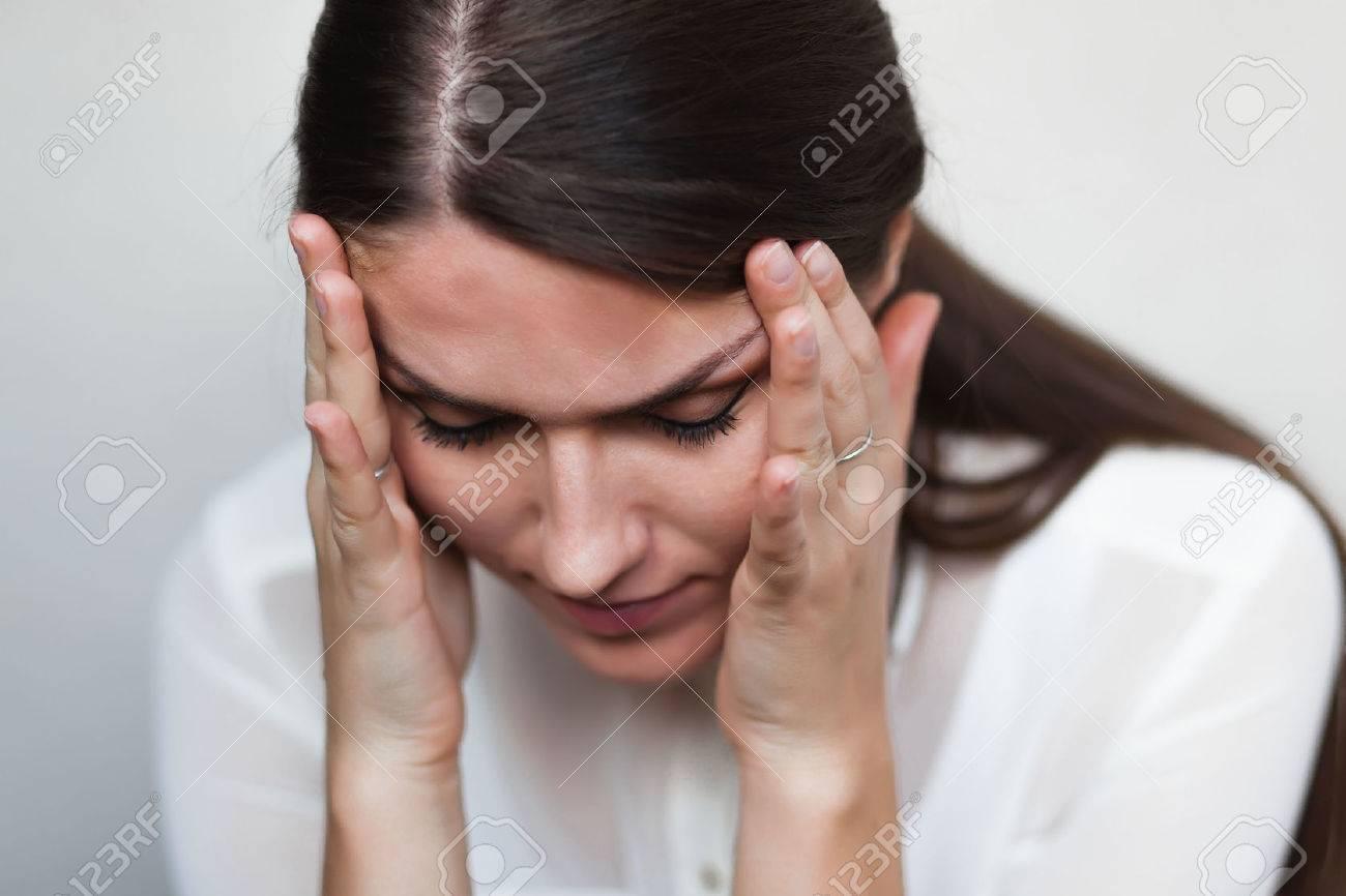 young sad girl headache Standard-Bild - 33720025