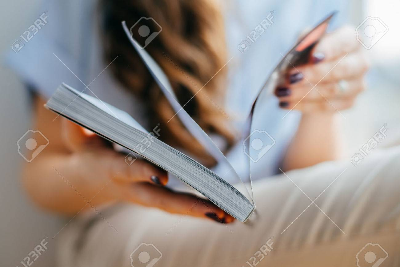 home and leasure concept - smiling woman reading magazine at home near the window Standard-Bild - 42327533