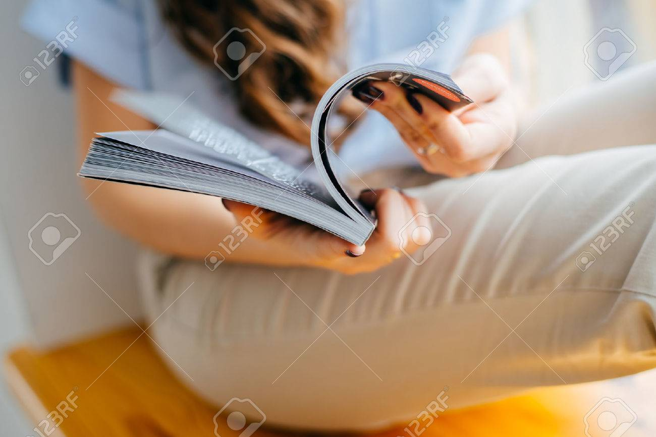 home and leasure concept - smiling woman reading magazine at home near the window - 42327642