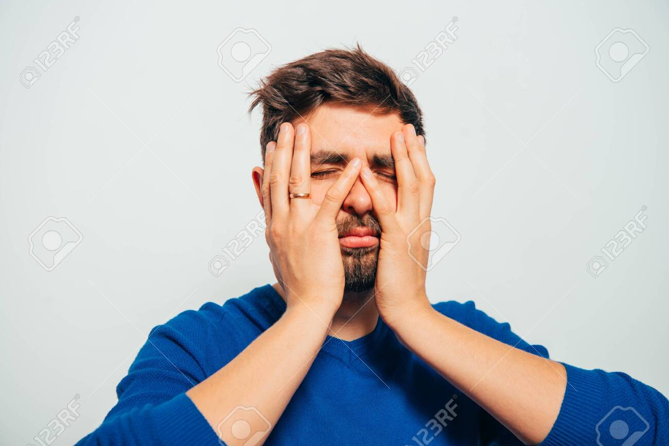 man covered his face with his hands - 143224126