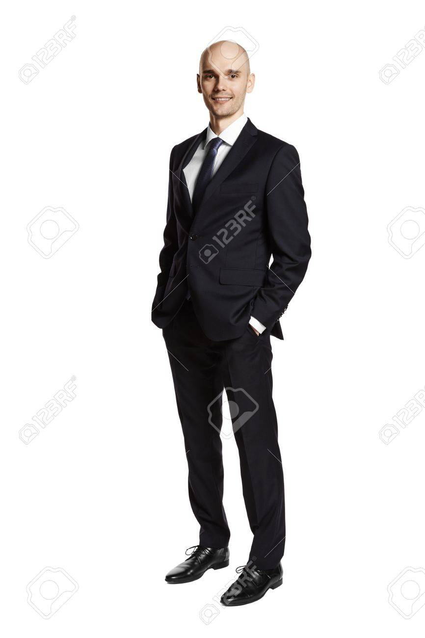 9b57b10047 Full length portrait of young man i black suit. Hands in pockets. Isolated  on