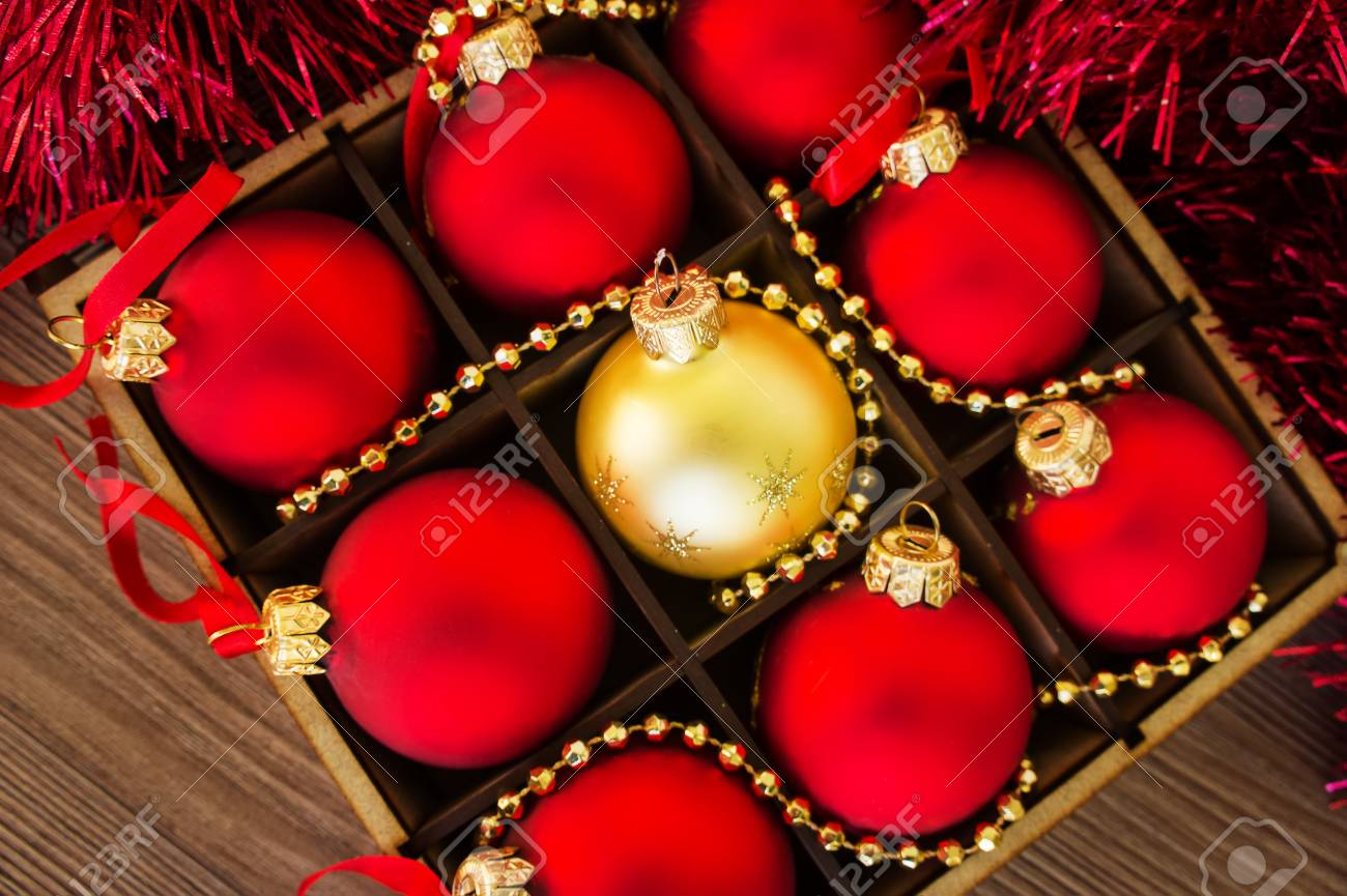 Christmas Red.Christmas Red And Gold Balls On The Wooden Table