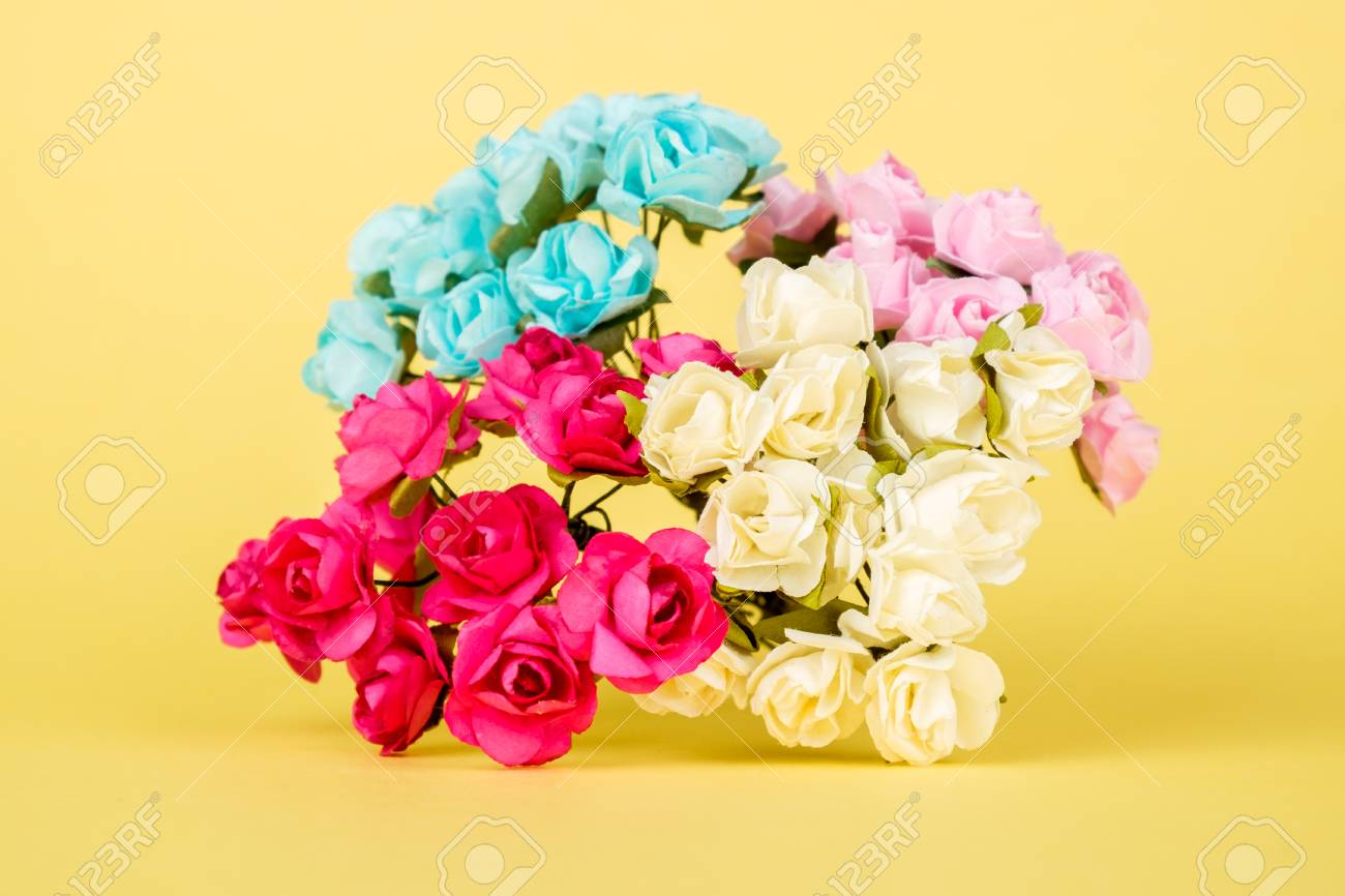 Beautiful Artificial Flowers On Colourful Background Isolated Stock