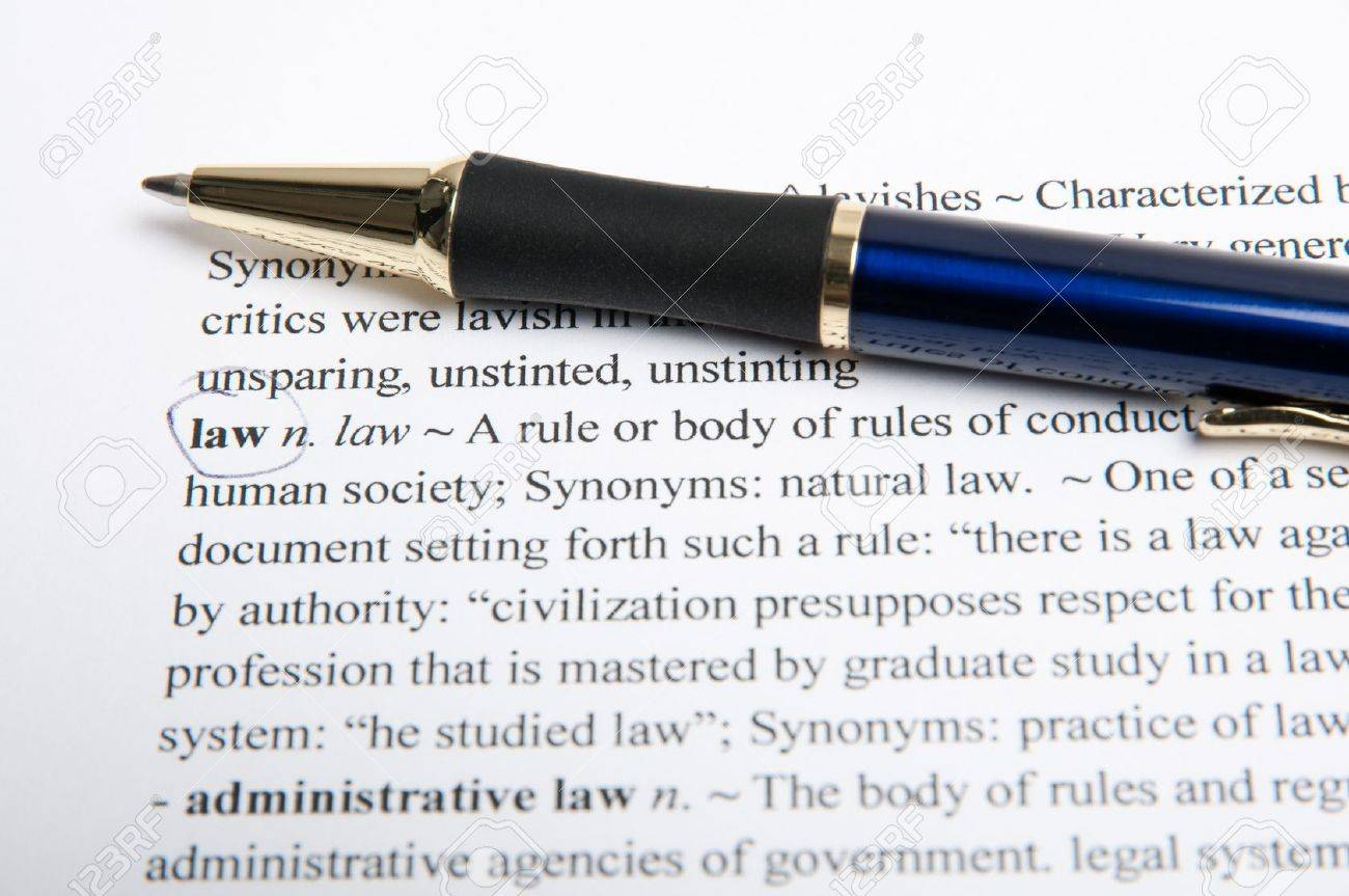 Translation of the word law in the dictionary with pen Stock Photo - 9537275