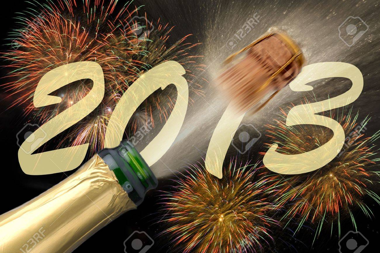 popping champagne at new year firework 2013 Stock Photo - 12674660